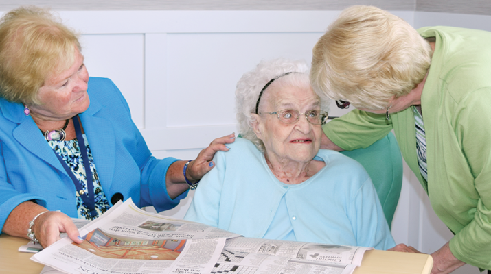 Pictured from left are Cheryl O'Brien, director of social services at Elderwood at Amherst; resident Edith Sawicki and her daughter, Gail Bolster, discussing articles in the daily newspaper.