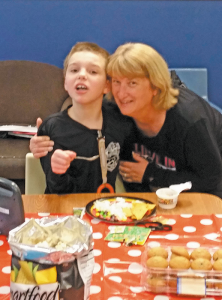 Debbie Cordone of Cheektowaga recently started Fantastic Friends of Western New York, a nonprofit that works with kids with autism and their families. Next to her is James, her son.