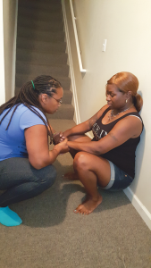 Birth Doula Shannon Johns teaching an expectant mother internal focusing in the squatting position.