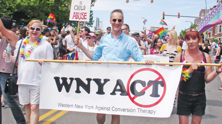 Paul Morgan, founder of Western New Yorkers Against Conversion Therapy (in blue) leading a recent parade against conversion therapy. To the right of him is Lorri Johnson, who is an LGBT activist from Jamestown.