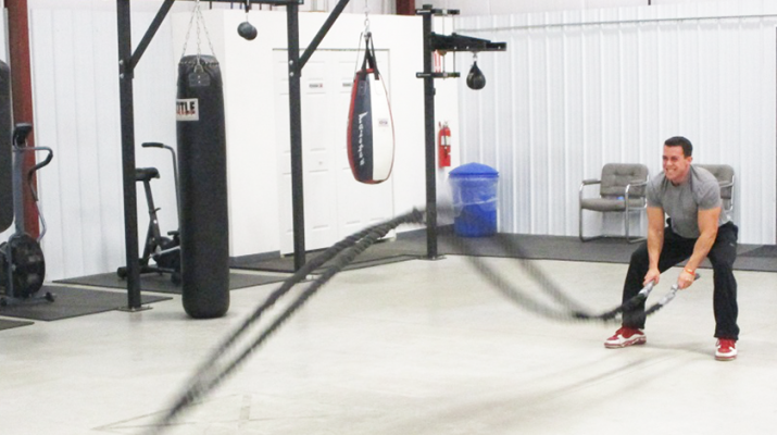 Impact Fitness: Strength Trainer Chris Cammarata demonstrates the battle ropes