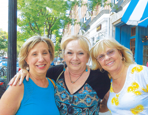 Solo Travelers Club members (from left): Deb Rouviere of Syracuse, Karen Sheldon and Sherry Gillis, both from Rochester, posed for this photo after enjoying a winery tour and delicious lunch in Skaneateles.