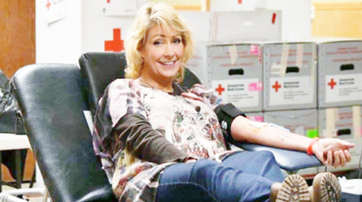 Carolyn Woomer donating blood at blood drive in Tonawanda in her son's, Jed, memory.
