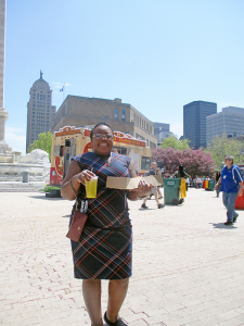 Cavette Chambers enjoys a healthy chicken option from Ted's Hot Dogs in downtown Buffalo.