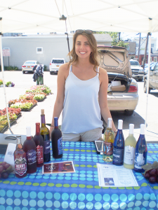 Kara Schanbacher of Lake View pours wine samples from Winery of Ellicottville every Saturday morning at the Hamburg Farmers' Market.