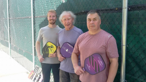 Pickleball can be a family-oriented activity enjoyed by people of all ages. Pictured from left are Kyle Gray, Peter Gray and Kevin Gray.