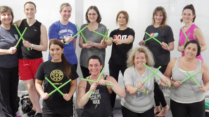 Participants at April Woolley's Tuesday night POUND class at the Fisher-Price Fitness Place in East Aurora. POUND has become the new trend in exercising in Western New York
