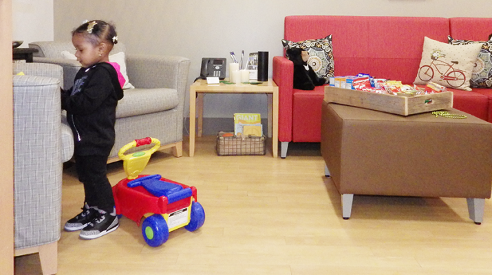 A child plays with toys at The Ronald McDonald House Family Lounge on the fifth floor of Oishei Children's Hospital.
