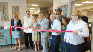 A ribbon cutting event in July to celebrate RSI's Renewal Center on Elk Street, which is part of its crisis diversion program at Restoration Society, Inc. From left: Nancy Singh, CEO, Restoration Society, Inc.; Joe Woodward, Housing Options Made Easy; Tara Karoleski, Erie County Dept. of Mental Health; Michael Ranney, Erie County Commissioner of Mental Health; Jon Grieco; Maura Kelley, Mental Health Peer Connection.