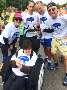 Celebrating a successful race is participant Jess Rubin, her mother Vickie Rubin, and RACIN! volunteers Eric Frank, Frank Cammarata and Kevin Penberthy.