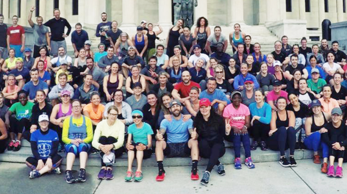 Members of the Buffalo chapter of the November Project. They're in front of the Albright-Knox Art Gallery during one of their Wednesday morning workouts.
