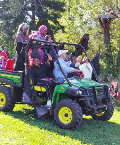 Physician Christopher Kerr, CEO of the Center for Hospice and Palliative Care, takes some refugees to tour his East Aurora farm.