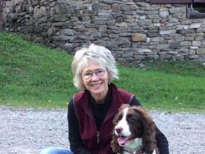 Gwenn Voelckers and her dog Scout enjoying some leaf peeping at Harriet Hollister Park at the end of Canandaigua Lake.