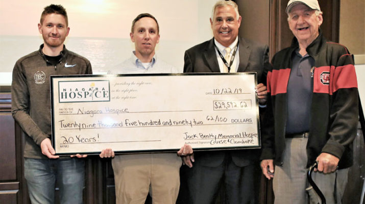 The Jack Beatty Memorial Hospice Cruise & Clambake event committee presents a check for $29,592.62 from the proceeds of the 20thanniversary held in July. From left are: Paul Beatty, III; Adam Burns, John Lomeo, Niagara Hospice president & CEO, and Paul Beatty, Sr.