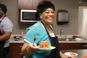 GBUAHN member Terry Daniels-Brown presents her stuffed tomato dish, made during one of GBUAHN's Member Cooking Classes.
