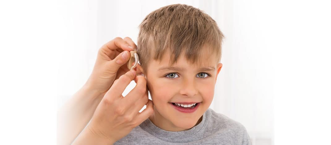Boy with hearing aid