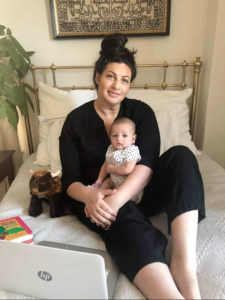 """Vanessa Fineberg, an admissions screener for Elderwood, with baby Vincent. """"COVID changed all of our plans,"""" she says."""