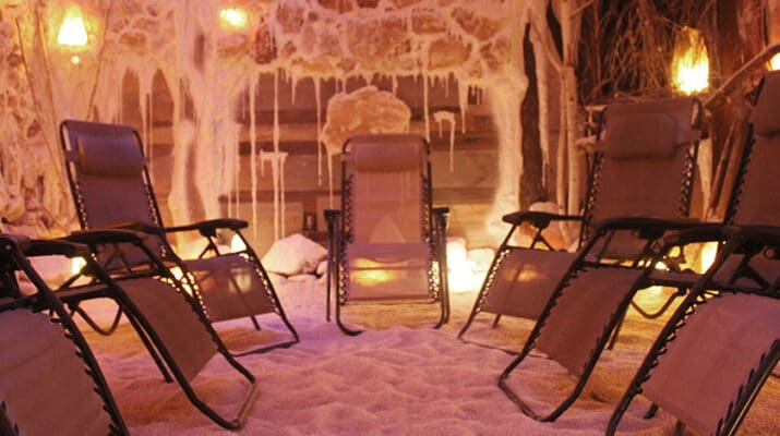 "Room at AURA Salt Cave and Wellness, Western New York's first halotherapy center, opened in 2017. ""Our salt cave has about 22,000 pounds of salt brought in from Poland and is made to look like an actual salt cave,"" says the owner, Kelly DeBerg."