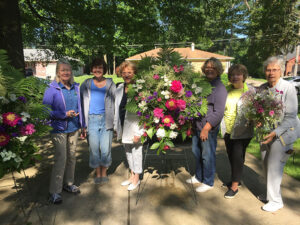 Members of the Hamburg Garden Club gathered flowers from their own gardens and put together floral arrangements for the Hamburg High School graduation, a project they undertake annually.