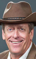 """Kent Taylor, the founder and CEO of the Texas Roadhouse restaurant chain, died from suicide at age 65. following """"a battle with post-COVID related symptoms, including severe tinnitus."""