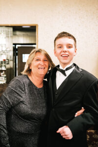 Debbie Cordone is the founder and president of the Fantastic Friends of Western New York. Next to her is James, her son