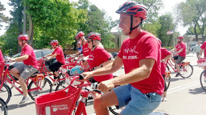 Michael Galligano, CEO of Shared Mobility Inc., the Buffalo-based nonprofit that partnered with Independent Health to bring Reddy bikeshare to Buffalo. Galligano is shown with a group of other bikers during a July 21 press conference at Delaware Park in Buffalo.