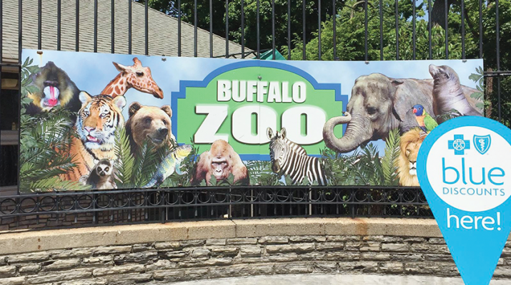 """Blue sign at the entrance of the Buffalo Zoo indicates that the organization is one of the participants in the Blue Discount,"""" a free, value-added benefit offered to the health plan's commercial members to encourage healthy living and activity."""
