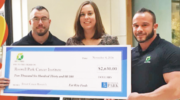 Owner of Eat Right Foods Luke Bright (left) and Mike Delzoppo (right) donating $2,630 to Roswell Park Cancer Institute for breast cancer research.