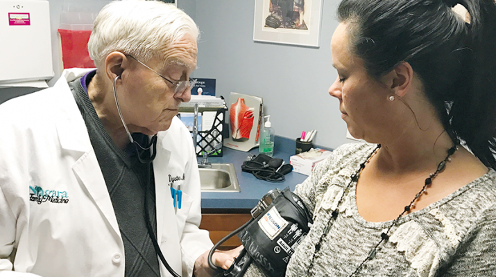 Physician Dyster with a patient, Renee Willard-Larson. Photo by Angie Lucarini.