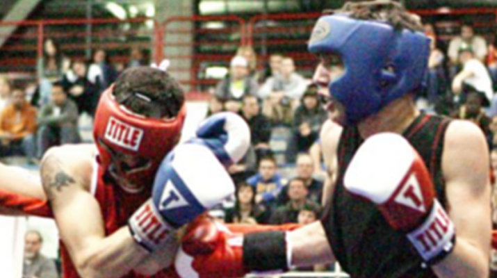 Akhmend Aliyev of Buffalo deliveres a series of body blows to his opponent this recent bout involving Buffalo Golden Gloves.