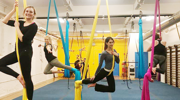 Practicing their aerial skills at Up! Aerial Fitness in Buffalo. Students and instructors will perform their first show June 16.