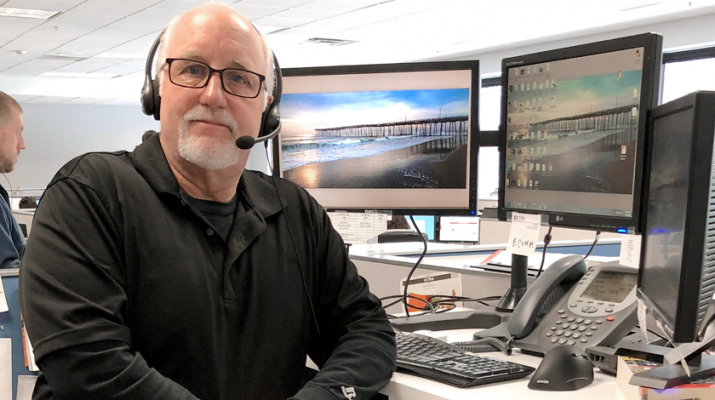 """Thomas Stevens, 63, at his sit-stand workstation in Williamsville where he's experienced the benefits. """"It's a great option to have during the workday. It helps your stress levels and it's refreshing to stand up and stretch."""""""