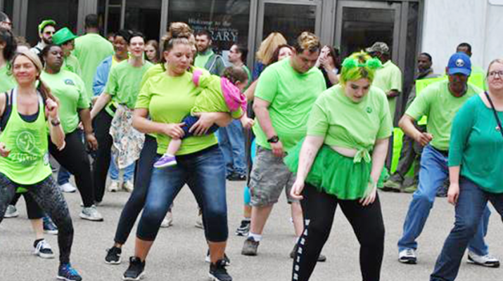 RSI staff and volunteers dance at the Flash Mob annual awareness event at the Central Library in Buffalo in May.