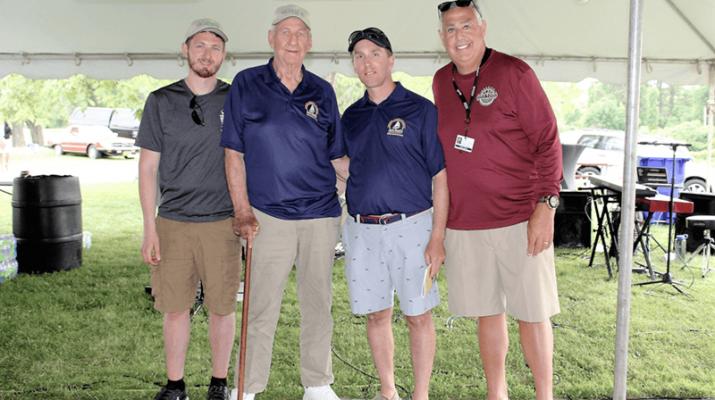 Raising fun for the Niagara Hospice: Paul Beatty III, Paul Beatty Sr., Adam Burns, and CEO of Niagara Hospice John Lomeo are all smiles at the 20th Annual Jack Beatty Memorial Hospice Cruise and Clambake.