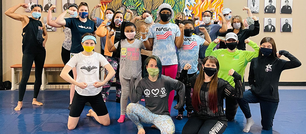 Students from a recently held self-defense class held at WNY Mixed Martial Arts & Fitness in Buffalo pose following an intense session.